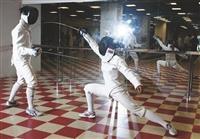 擊劍往往在轉瞬之間就決定了勝負,圖為隊員練習的畫面。(攝影/林奕宏)