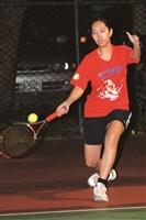 正在進行例行訓練的女網隊員,動作流暢敏捷。(攝影/林奕宏)