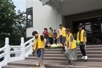 淡水校園106-2商管大樓地震避難掩護演練與災害防救宣教活動