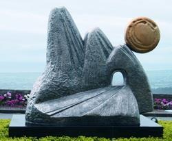 於民國95年3月揭幕的雪山隧道雕塑, 象徵本校創始淡水,繫心蘭陽, 寄情雪山之情懷。
