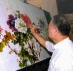 名畫家戴子超現場揮毫牡丹畫作《富貴春》,不到一小時就完成精美畫作,莫不讚嘆大師功力。(張佳萱攝)